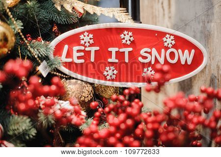 Sign Saying Let It Snow
