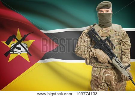 Soldier Holding Machine Gun With Flag On Background Series - Mozambique