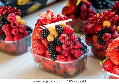 Plastic Box Of Fresh Healthy Fruit Currant And Strawberry