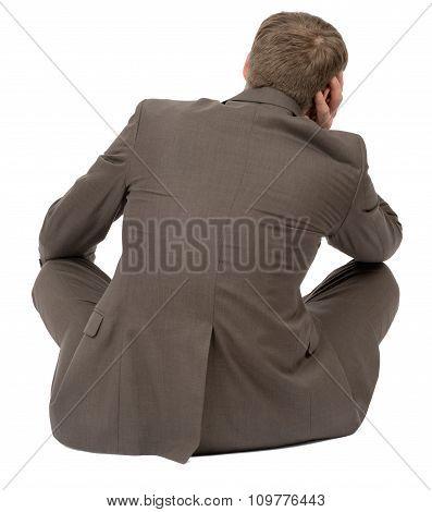 Man sitting in lotus posture, rear view