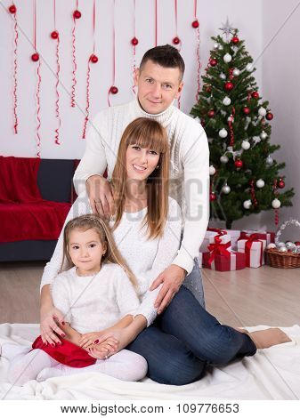Christmas And New Year Concept - Family With Decorated Christmas Tree