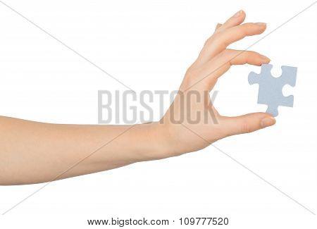 Arm holding puzzle piece