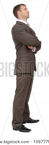 Businessman standing, side view