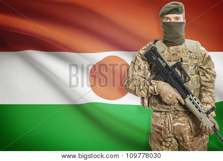 Soldier Holding Machine Gun With Flag On Background Series - Niger