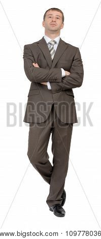 Businessman with crossed arms and legs