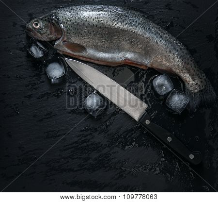 Fresh Trouts With Ice And Knife