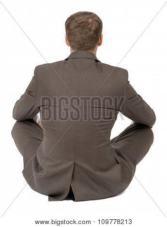 Businessman sitting in lotus posture, rear view