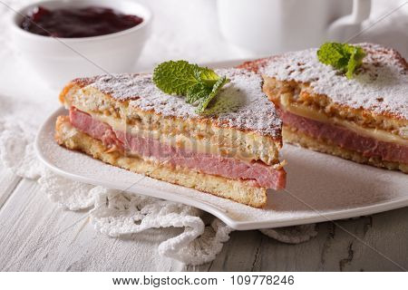 Sandwich Of Monte Cristo Close-up On A Plate And Berry Jam.