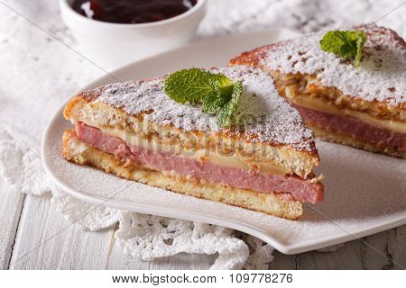 Monte Cristo Sandwich With Powdered Sugar Closeup. Horizontal