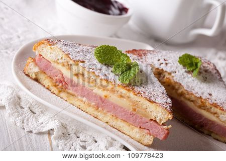 Tasty Sandwich Of Monte Cristo With Ham And Cheese Close-up