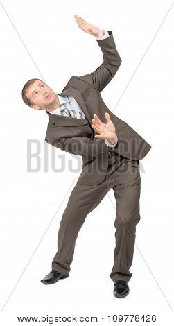 Businessman bending and looking up