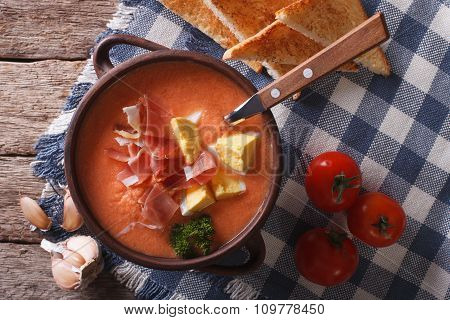 Salmorejo Soup With Ham And Eggs In A Bowl Close-up. Horizontal Top View