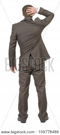 Thinking businessman on white, rear view