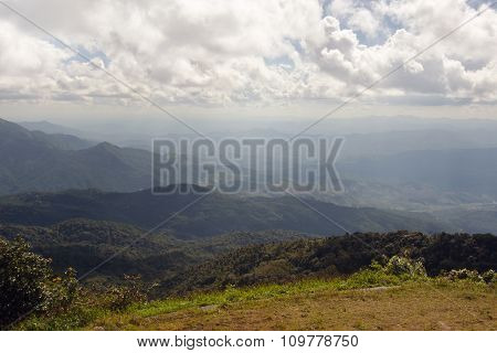 Grass, mountain and cloudy sky view of Chiangmai Thailand