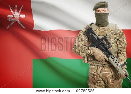 Soldier Holding Machine Gun With Flag On Background Series - Oman