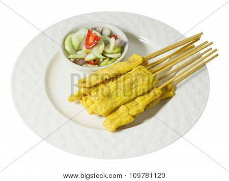 Grilled Pork Satay With Cucumber Salad On White Background