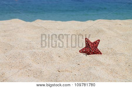 red star on the sand