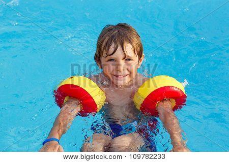 little boy having fun in an swimming pool