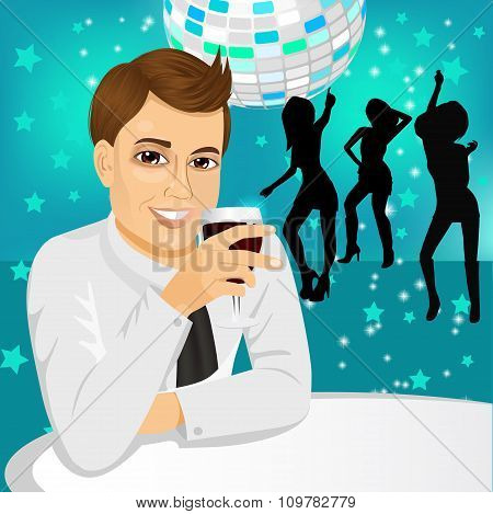 businessman drinking wine at the party