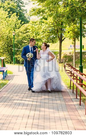 bride and groom is walking together
