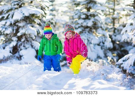 Children Playing In Snowy Winter Park