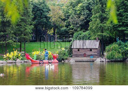 Custodian Cleans A Pond In Public Park