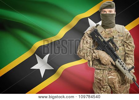 Soldier Holding Machine Gun With Flag On Background Series - Saint Kitts And Nevis