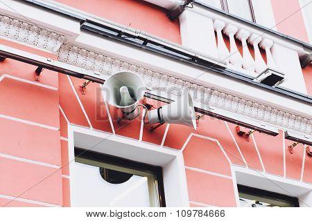 loudspeaker mounted on an old building