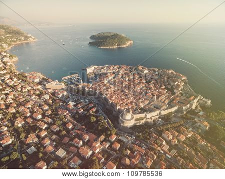 Aerial view of old city of Dubrovnik (Croatia), popular tourist attraction on Adriatic. Lokrum island in the background. Post processed with vintage filter.