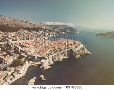 Aerial view of old city of Dubrovnik (Croatia), popular tourist attraction on Adriatic. Srdj mountain in the background. Post processed with vintage filter.