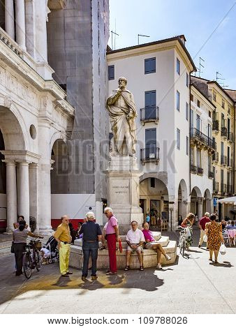 People Rest In Front Of Statue Of Andrea Palladio