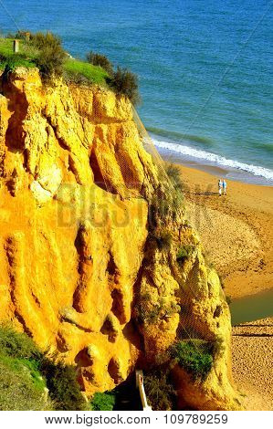 Couple enjoying a walk on Albufeira Beach