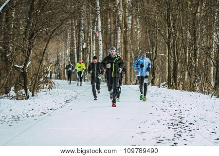 group of men running on winter alley