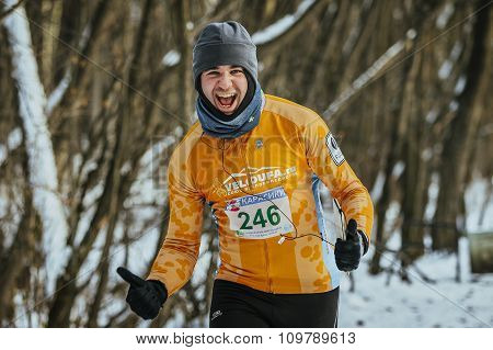cheerful young man runner