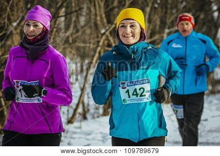 two middle-aged women running
