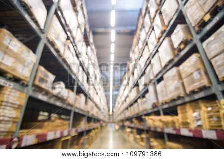 Abstract Blurred Boxes On Rows Of Shelves