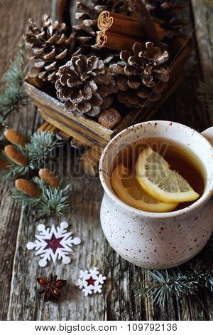 New Year's Spirit: Cup Of Tea With Lemon And Pine Cones