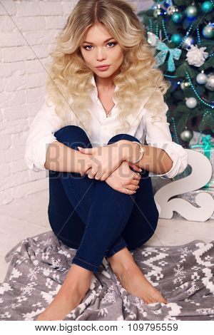 Beautiful Woman  At Cozy Home, With Presents And New Year Decoration