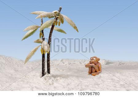 sad clay monkey sitting in the snow near the snow-covered bananas palms