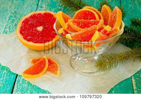 Marmalade Grapefruit Slices On A Wooden Table