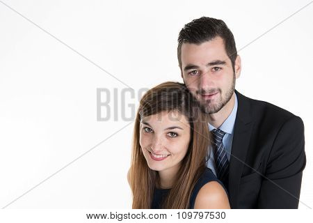 Cheerful Young Couple Standing On White Background,