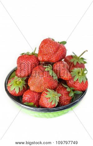 Strawberries In Clay Bowl Isolated On White Background. Closeup.