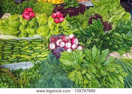Salad and herbs at a market