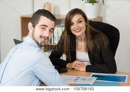 Image Of Two Young Business Partners At Meeting
