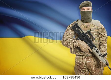 Soldier Holding Machine Gun With Flag On Background Series - Ukraine