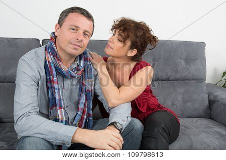 Romantic Couple On Sofa Happy Together And Relaxing