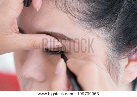 Makeup Beauty With Brush Eye Liner On Pretty Woman