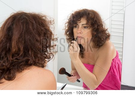 Woman Applying Lips Contour In Her Bathroom