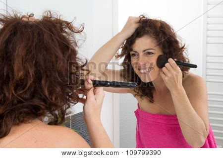Woman Is Applying Powder On Her Face