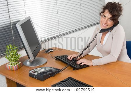 Business Woman Working In Office On A Grey